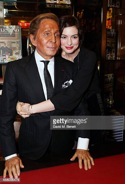 Mr Valentino Garavani and Anne Hathaway attend the opening of Maison Assouline as Valentino signs copies of his new book 'Valentino At The Emperors...