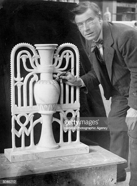 Mr W Aumonier at work on an alabaster flower vase from the tomb of Tutankhamen for the British Empire Exhibition at Wembley London