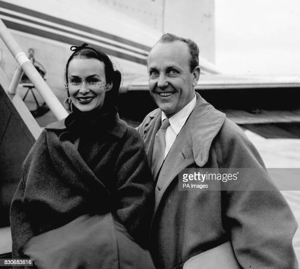 Mr William Randolph Hearst American newspaper magnate and Mrs Hearst are seen as they board a BEA Viking plane at Northolt Airport for Paris on their...