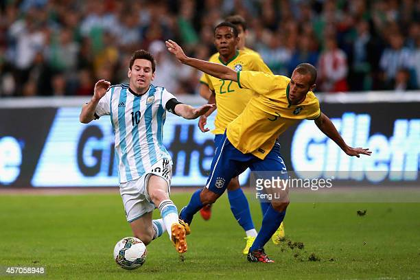 Mranda of Brazil competes the ball with Lionel Messi of Argentina during Super Clasico de las Americas between Argentina and Brazil at Beijing...