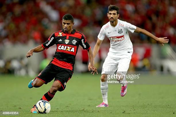 Márcio Araújo of Flamingo eludes Alan Santos of Santos during a match between Flamengo and Santos as part of Brasileirao Series A 2014 at Maracana...