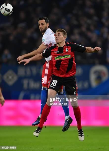 Mrgim Mavraj of Hamburg is challenged by Nils Petersen of Freiburg during the Bundesliga match between Hamburger SV and SC Freiburg at...