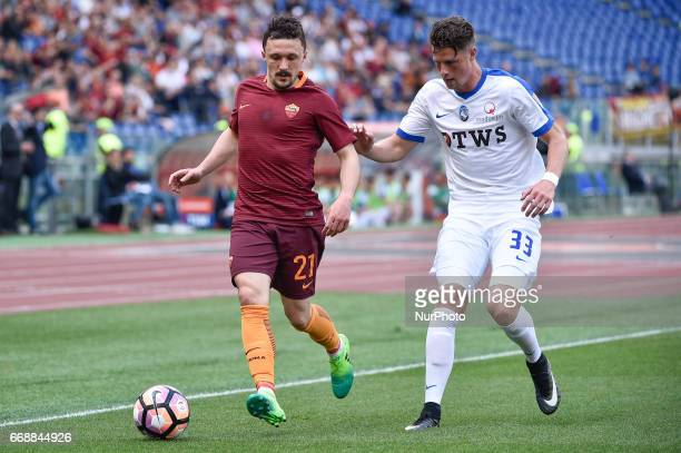 Mrio Rui of AS Roma is challenged by Hans Hateboer of Atalanta during the italian Serie A match between Roma and Atalanta at the Olympic Stadium Rome...