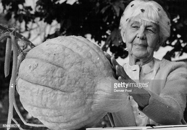 Mrs Ada Andersen Admires 32pound squash she grew in Yard Credit Denver Post