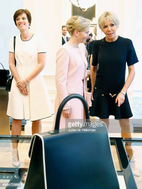 Mrs Amelie Derbaudrenghien Mrs Mojca Stropnik and French First Lady Mrs Brigitte Macron are pictured during the visit of the partners of the heads of...