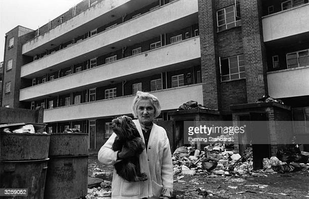 Mrs Annie Breach stands amidst the rubbish outside her council flat in Hackney London