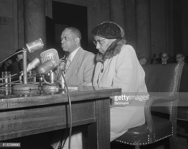 Mrs Annie Lee Moss who was named as a 'card carrying' Communist in 1944 and currently employed in the pentagon's code room is shown with her attorney...