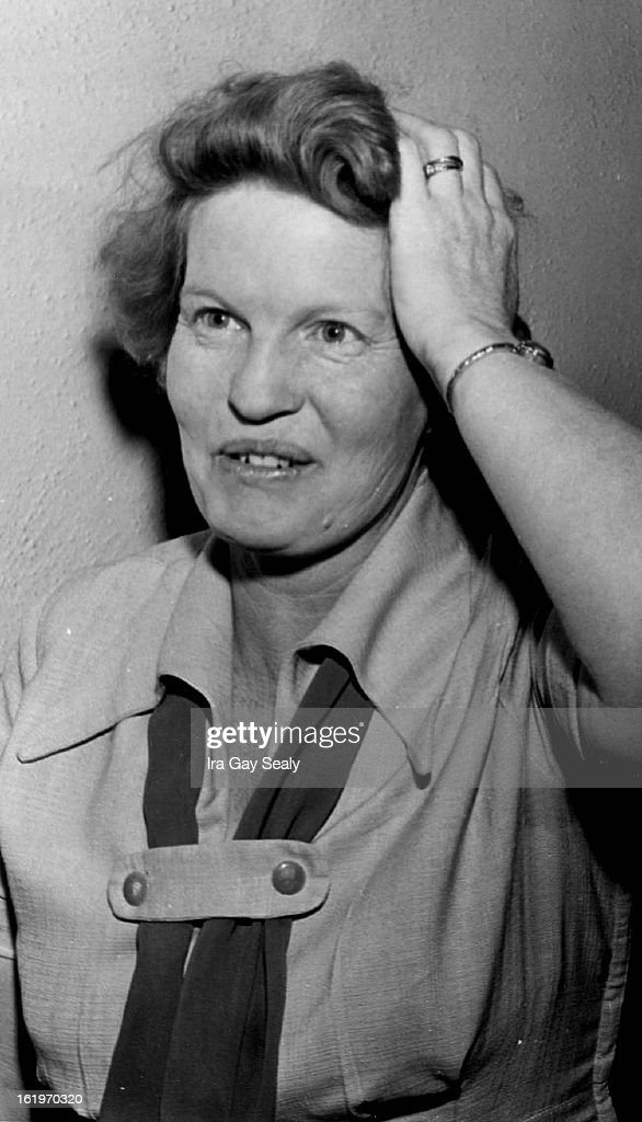 FEB 1959 2211959 Mrs Arline Figaro of 790 S Decatur St an elevator in the Kittredge Building 511 16th St holds on ***** on her head after she was hit...