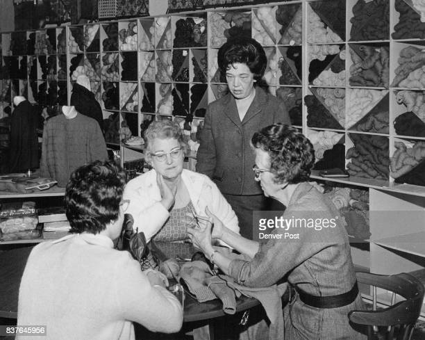 Mrs Betty Richardson owner of Colonial Knit Shop watches as Mrs Hans Fugleberg Jr back to camera and Mrs R N ' Fisher are given tips at the Aurora...