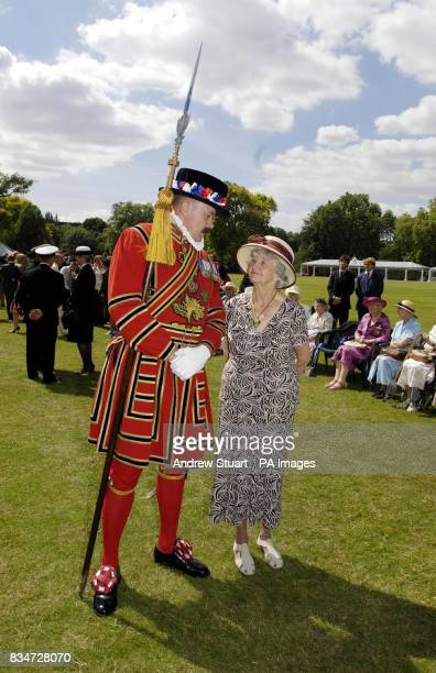 Mrs Bridget Fowler 81 meets former Royal Marine now Yeoman George Forster at a garden party arranged by the Not Forgotten Association Buckingham...