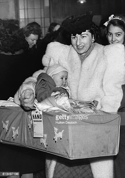 Mrs Bruce Lawrence and her daughter Maureen Hazel Lawrence who is 6 months old are among a group of GI brides and 190 babies who are leaving Waterloo...