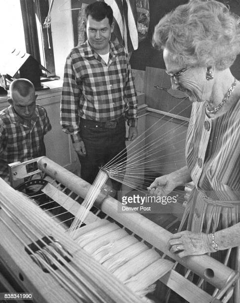 Mrs C M Searl teacher gives a lesson in operating a loom to Kenny Ross left and her own son Larry two of the 31 students now enrolled in the Tiny Tim...