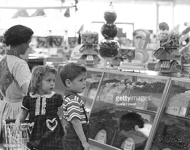FEB 7 1963 FEB 13 1963 Mrs CF Decker 1745 S Shoshone St and her children Cassandra and Brent think the candy is dandy in the Hested store display of...