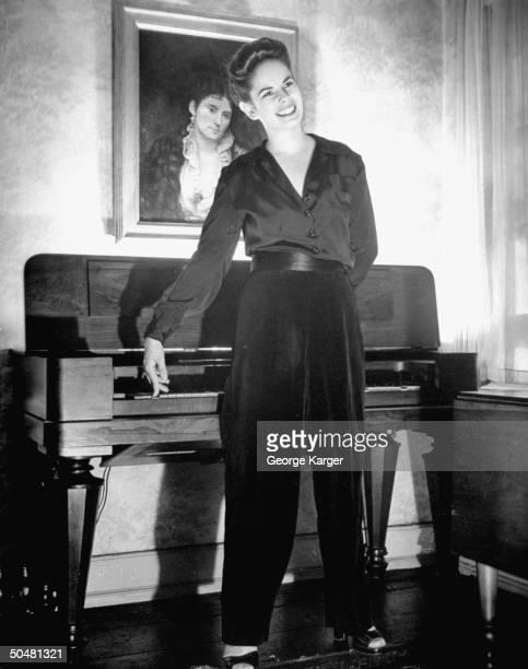 Mrs Charles Chaplin Oona O'Neil Chaplin pressing a key on the piano
