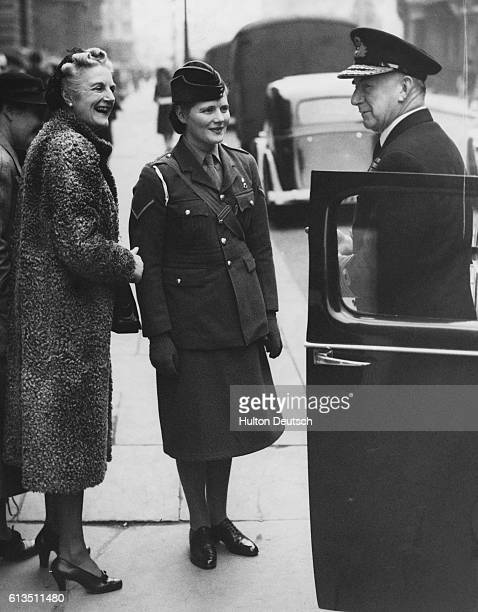 Mrs Churchill the wife of the War time leader and Conservative Prime Minister Sir Winston stops to chat to Dudley Pound whilst out walking with her...