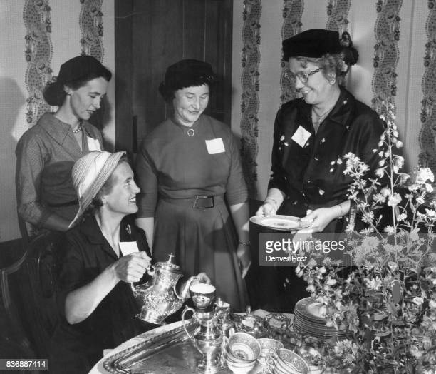 Mrs Claude Maer Jr pours tea for Mrs John W Coxhead Jr Mrs Omer Griffin and Mrs McKinnie Phelps at a recent meeting held for the committee working on...