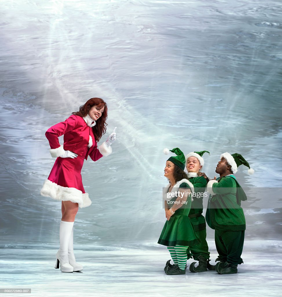 'Mrs Claus' waving finger at three 'elves' (Digital Composite)