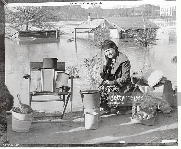 Mrs CW Voyles sits disconsolately in the midst of a few possessions she was able to salvage when the swollen Chattahoochee River inundated her home...