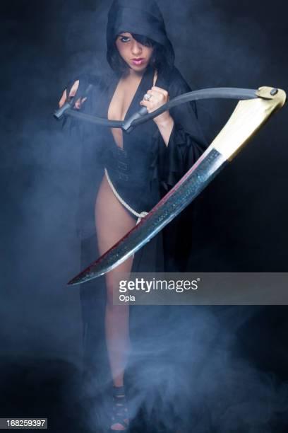 Mrs. Death holding a scythe