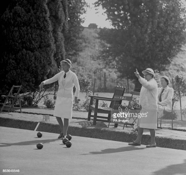 Mrs E Bryant of Bournemouth skip of the Hampshire four and Mrs E Routledge the Cumberland skip at Wimbledon Park London during the final of the Rink...