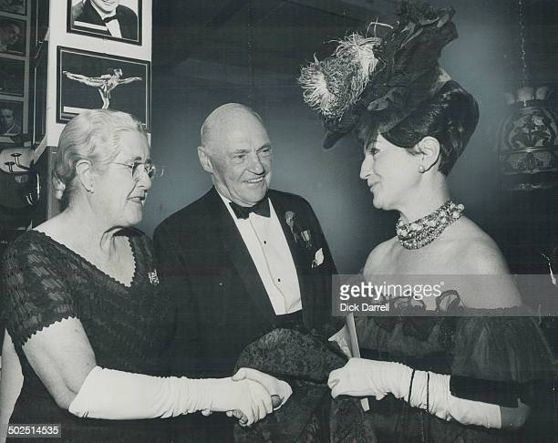 Mrs Earl Rowe shakes hand of Mrs Arthur M Winton while LieutenantGovernor Earl Rowe looks on The old with their memories and the young with their...