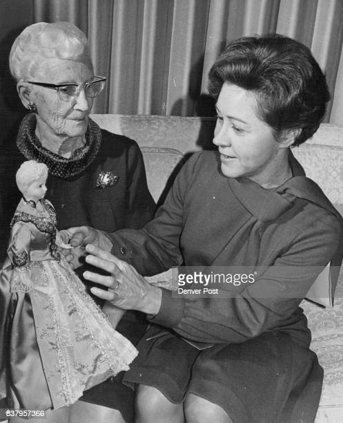 Mrs Edna Hodge left shows Mrs Aaron Green luncheon chairman doll inspired by inaugural gown of Mrs Benjamin Harrison Credit Denver Post