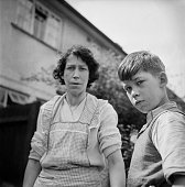 Mrs Elsie Fisher and her son Jackie in Old Mill Road Denham Buckinghamshire UK 27th August 1958 They are watching the police question passersby after...