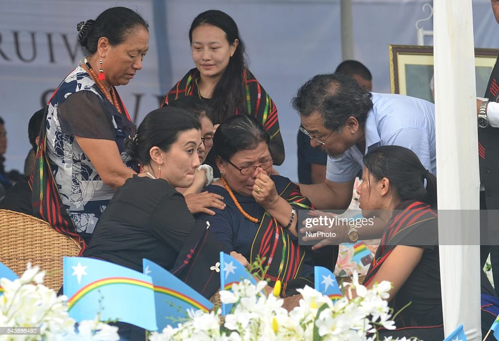 Mrs. Eustar Khulu (C) wife of late Isak Chishi Swu is comfort by relatives as she break down during the public funeral service in honour of Isak Chishi Swu, Chairman of the NSCN-IM at Dimapur, India north eastern state of Nagaland on Thursday, June 30, 2016. Thousands of mourners pay tribute to late Isak Chishi Swu chairman of the NSCN-IM who dies at a private hospital in Delhi on June 28.