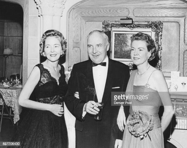 Mrs Eve Daly is pictured with New Year's Eve party hosts Mr and Mrs Frank L Tettemer The Tettemers and their guests welcomed 1961 at a sitdown black...