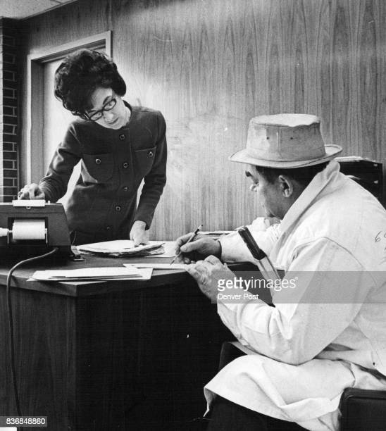Mrs Feuerstein's job includes getting daily meat processing data Here Ed Cech quality control manager makes report That's a butcher knife protruding...