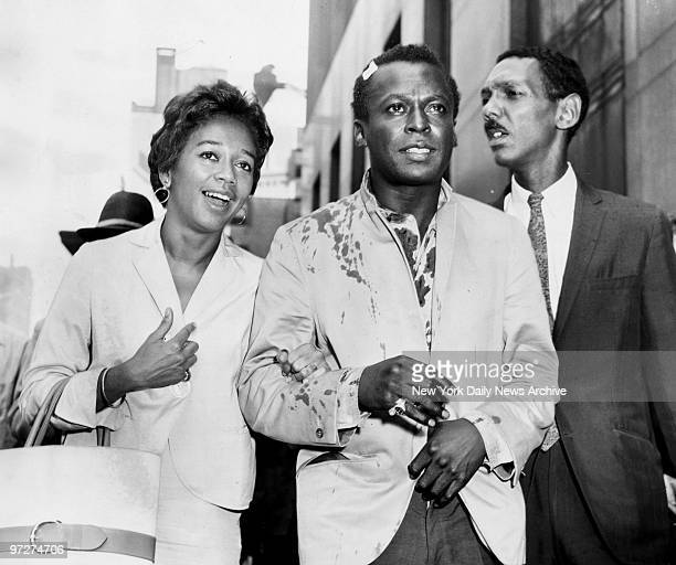 Mrs Frances Davis with her husband Miles Davis jazz musician who was released on $500 bail At right is his attorney Harold E Lovette