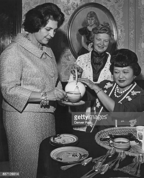 Mrs Frank Torizawa right pours tea for fellow cochairman of school Mrs Joseph Morrone left and Mrs Paul von Rosenberg Credit Denver Post