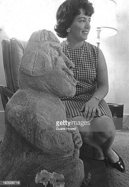 SEP 26 1967 SEP 29 1967 OCT 4 1967 Mrs Fred Meine 1827 Belloire St cochairman of the fair poses with Tiki the 'god of happy gardeners' which she...