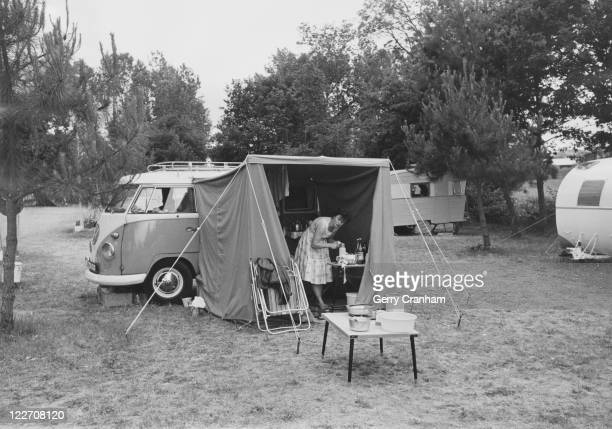 Mrs G Cranham of Mitcham on a camping holiday near Le Mans in her Volkswagen camper van with a tent extension June 1962