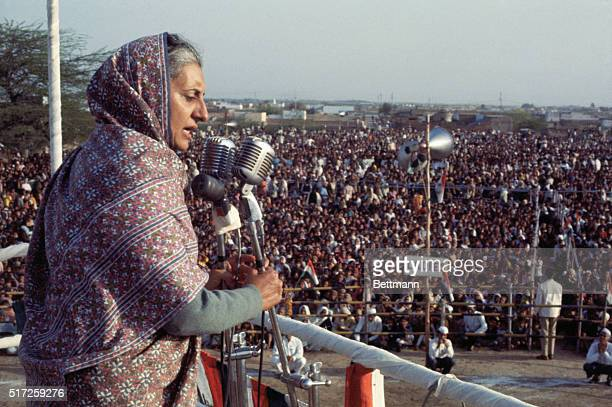 Mrs Gandhi Campaigns New Delhi India Mrs Indira Gandhi premier of India with her face surrounded by floral garlands addresses a public meeting...