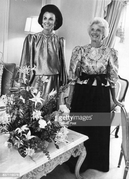 Mrs Gerald Altman left wears Oscar de la Renta's blouson gold lame Mrs S Charles Tobias wears black satin gown Credit Denver Post