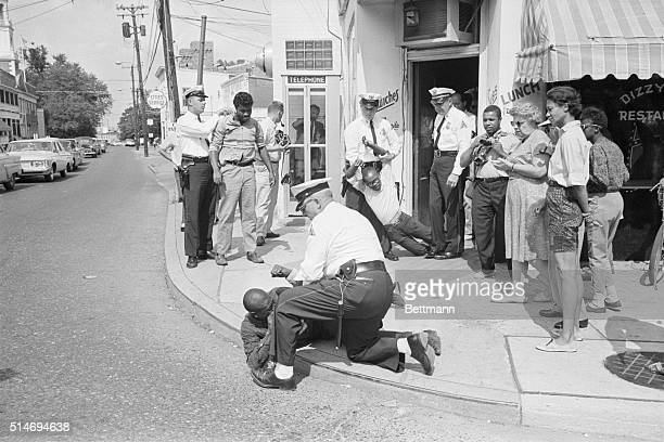 Mrs Gloria Richardson Chairman of the Cambridge NonViolent Action Committee watches as sitin demonstrators Johnny Weeks James Lewis and Dwight...