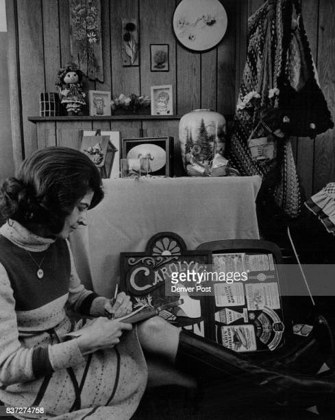 Mrs Harold Young makes note of handcrafted items of ***** members for boutique display at fashion show Credit Denver Post