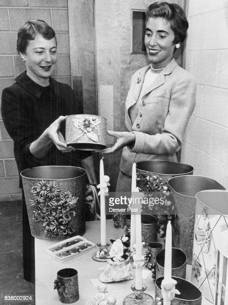 Mrs Hugh Fowler and Mrs Richard Chamberlin members of the Junior Committee of Goodwill Auxiliary examine products of the Hobbies Group on display at...