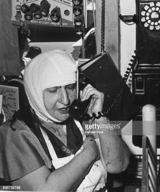 Mrs Ida Albert Talks On Telephone She was forced to hand over money to holdup man $150 Robbery Man PistolWhips Woman Grocer 59 Credit Denver Post