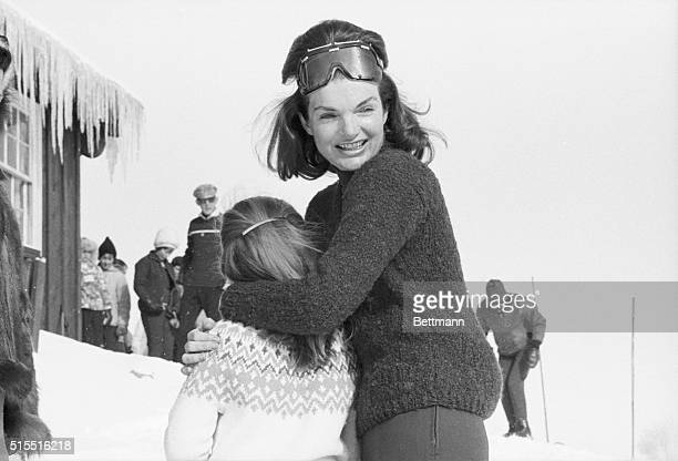 Mrs Jacqueline Kennedy laughs and embraces her daughter Caroline as the Kennedy family enjoys a ski holiday