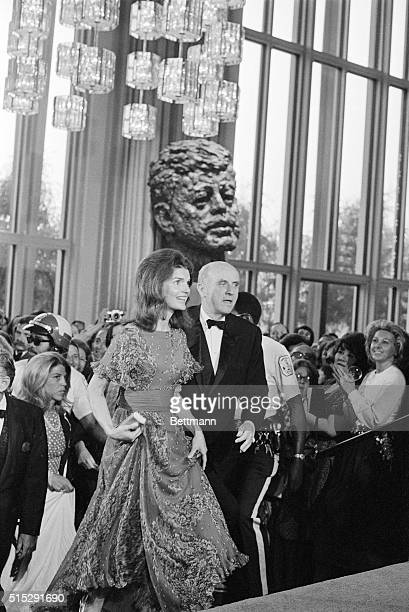 Mrs Jacqueline Kennedy Onassis passes a huge bronze bust of her late husband President Kennedy as she enters the John F Kennedy Center for the...