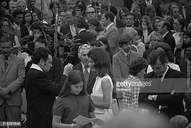 Mrs Jacqueline Kennedy Onassis receives Holy Communion from Monsignor Gino Barroni during a memorial Mass for the late Robert F Kennedy at Arlington...