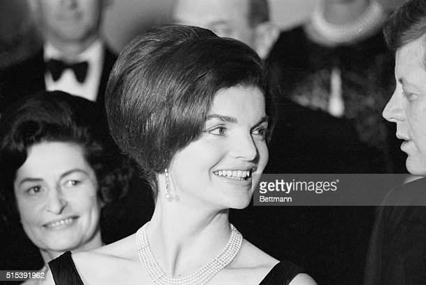 Mrs Jacqueline Kennedy wore this fancy hairdo at the state dinner she and President Kennedy gave at the White House late February 19th for visiting...