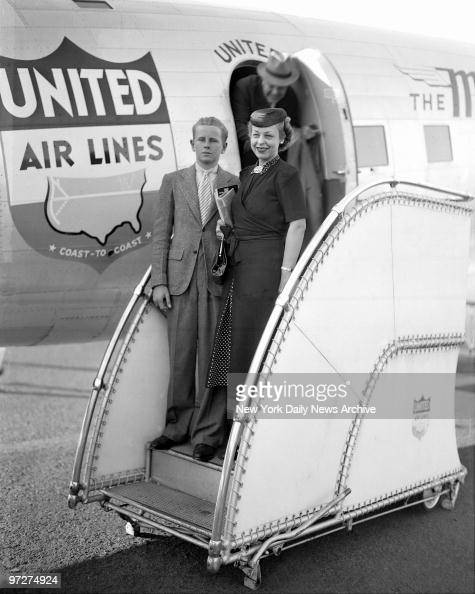 Mrs Jesse Livermore with her son Paul as she arrived on United Air Liner plan from Omaha where she was visiting her more Mrs Fred Metz She was met at...