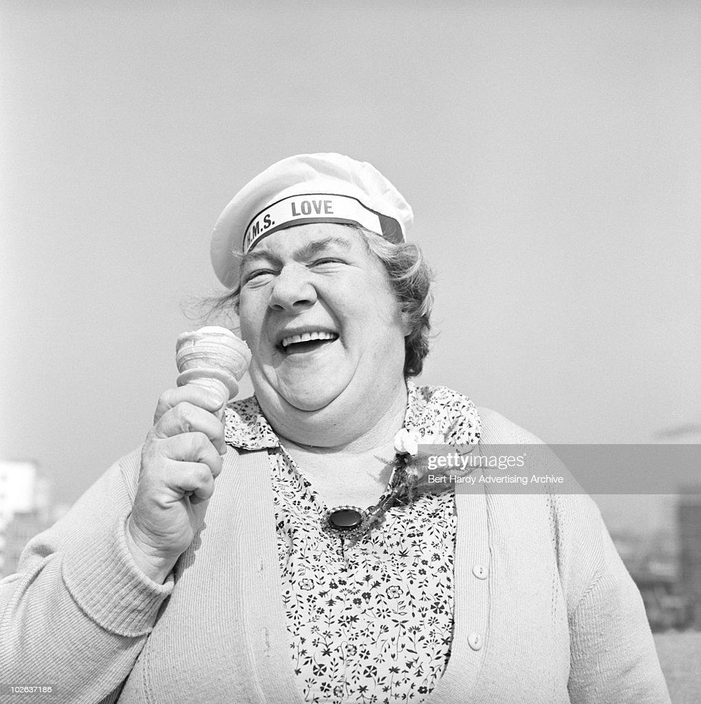 Mrs Jessie Starke eating an ice cream and wearing a novelty sailor's cap with the inscription 'HMS Love', 23rd March 1960.