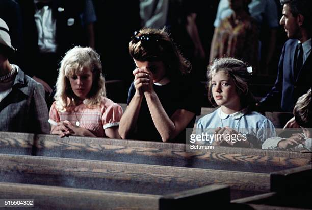 Mrs John F Kennedy and her children Caroline and John Jr pray in Saint Patrick's Cathedral as the body of Sen Robert F Kennedy lies in State