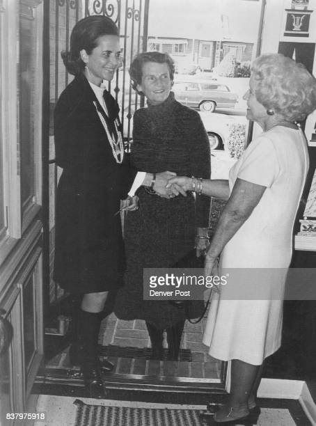 Mrs John Hall right greets Mrs Franklin Burns left and Mrs Edwin Francis at recent Heart Fashion Show committee meeting at her home Credit Denver Post
