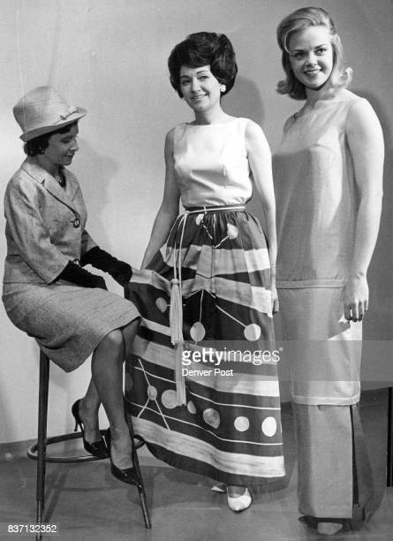 Mrs John Holberg studies fashions to be modeled by Mrs Norman Alverson and Cheryl Sweeten currently Mrs and Miss Colorado See 'Green sprouts' Credit...