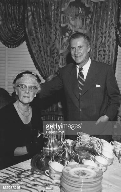 Mrs Joseph Bordy pours tea for Alexander Ivo at the Denver Civic theater final report membership tea on Thursday at the home of Mrs John Anthony...